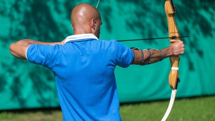 a man shooting his recurve bow