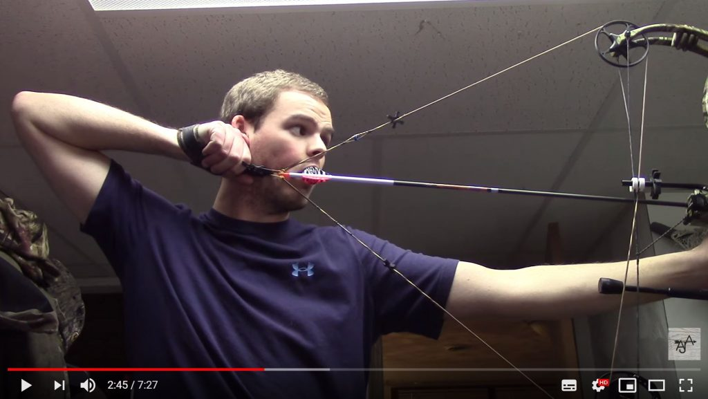 guy drawing bow and holding