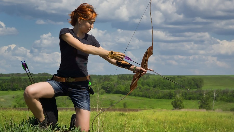 a woman drawing a bow