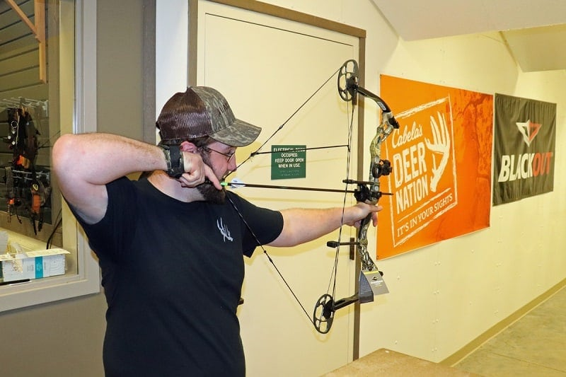 a man shooting the diamond prism compound bow