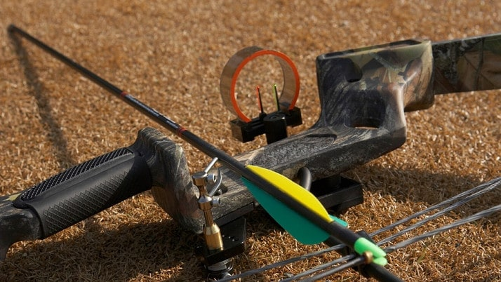 picture of a part of a compound bow resting on the ground