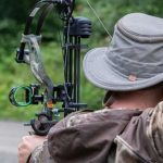 Hunter shooting compound bow