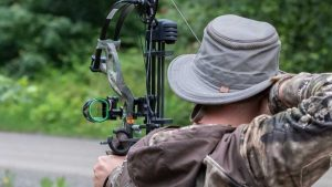 A Hunter shooting a compound bow