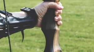 an holds recurve bow