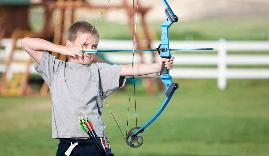 a-young-boy-shooting-a-compound-bow