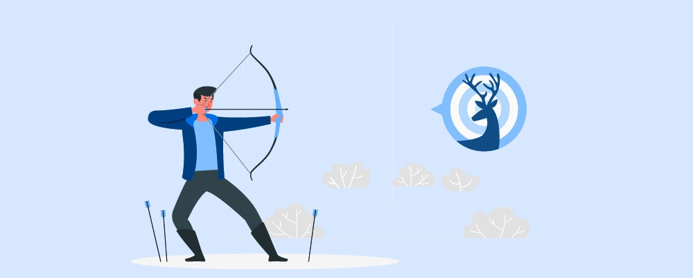 A person trying to hit a practice target with a bow and arrow