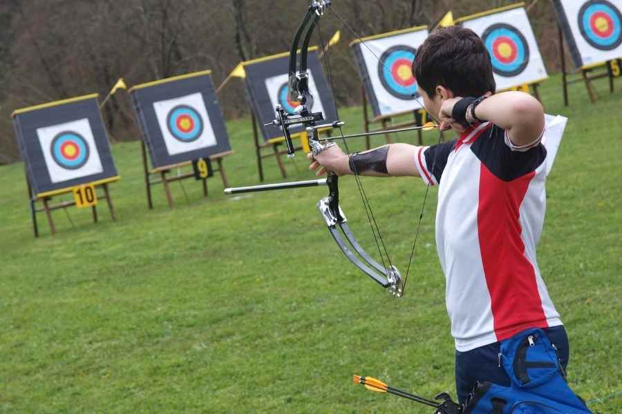 an archer shooting his compound bow at an archery range