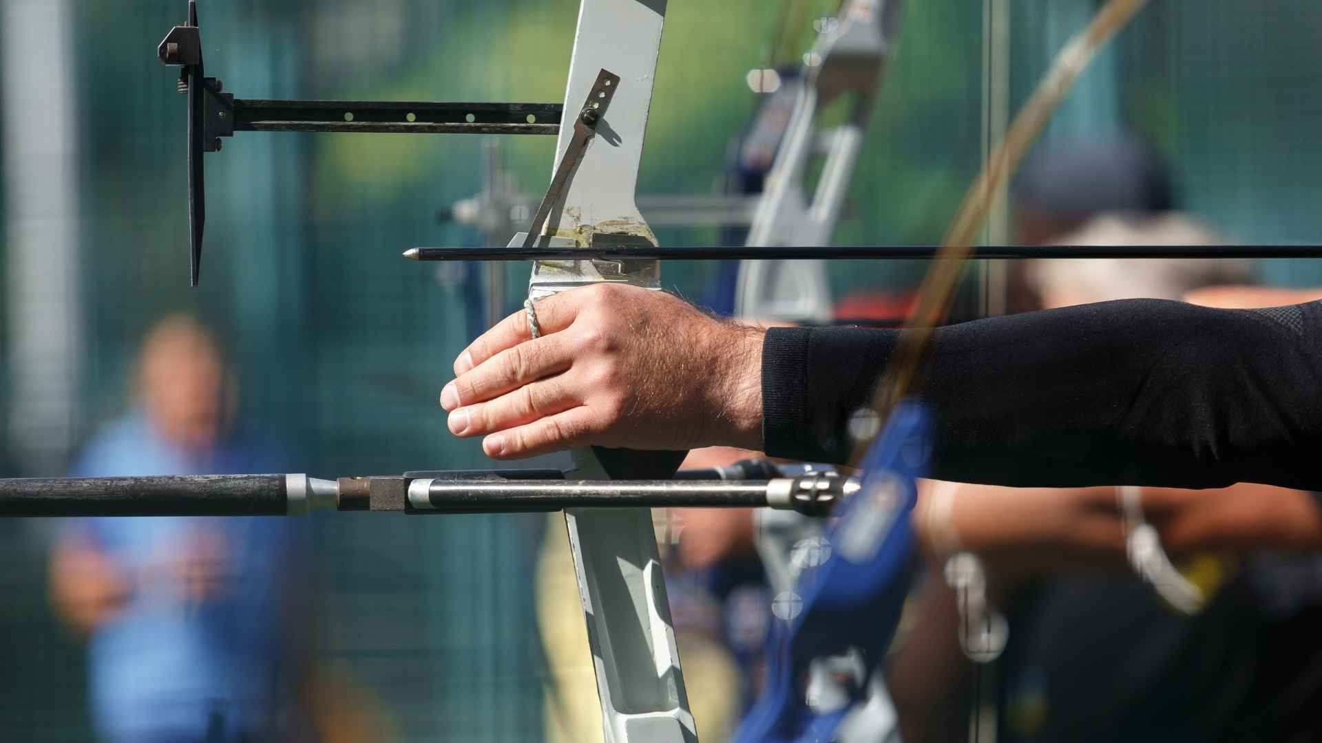 several archers drawing their bows side view with one hand (1)
